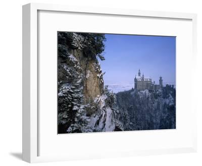 King Ludwig's Schloss Neuschwanstein, in a Snowy Mountain Landscape