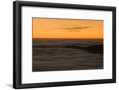 Mountain Tops in the Black Forest Break Through Fog at Sunrise