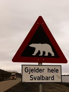 Polar Bear Crossing Sign in Svalbard, Norway, Svalbard, Norway by Norbert Rosing