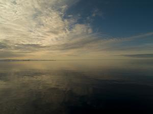 Serene View of Still Water under the Arctic Sky by Norbert Rosing