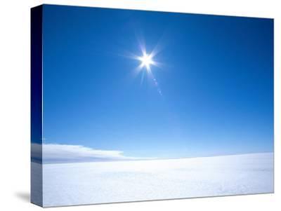 The Sun Appears as a Bright Pointed Star in a Crisp Blue Polar Sky