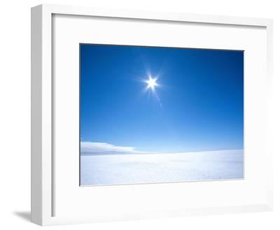 The Sun Appears as a Bright Pointed Star in a Crisp Blue Polar Sky