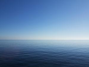 Blue Sky over Calm Sea by Norbert Schaefer