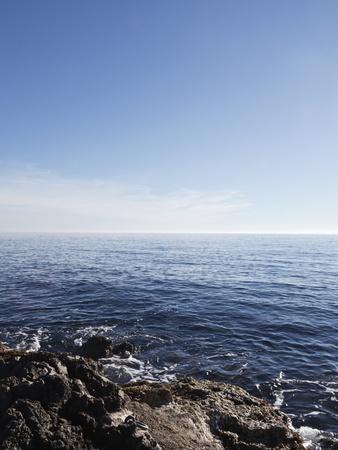 Blue Sky with Blue Sea and Rocks