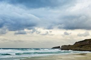 Overcast Sky above Waves Breaking at Beach by Norbert Schaefer