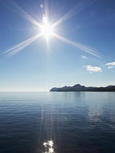 Sun Shining above Calm Sea by Norbert Schaefer