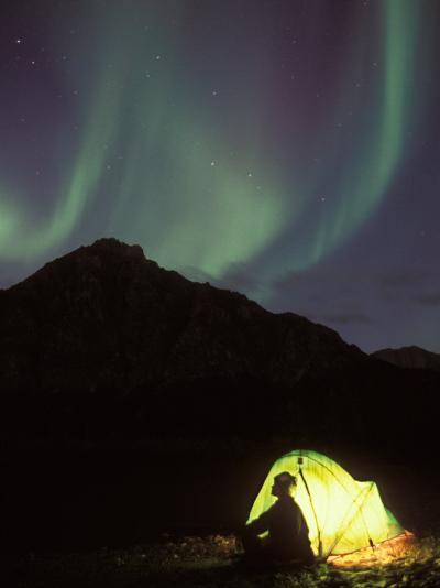 Northern Lights and Camper Outside Tent, Brooks Range, Arctic National Wildlife Refuge, Alaska, USA-Steve Kazlowski-Photographic Print