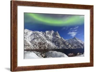 Northern Lights (Aurora Borealis) Illuminate the Snowy Peaks and the Blue Sky During a Starry Night-Roberto Moiola-Framed Photographic Print