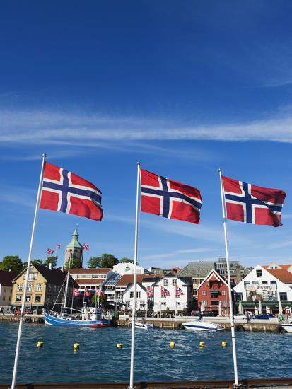 Norwegian Flags and Historic Harbour Warehouses, Stavanger, Norway, Scandinavia, Europe-Christian Kober-Photographic Print