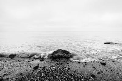 Nostalgic Sea. Waves Hitting in Rock in the Center. Black and White, far Horizon.-Michal Bednarek-Photographic Print