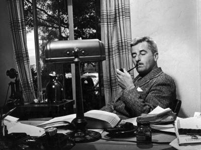 Novelist and Script Writer William Faulkner Smoking a Pipe at His Desk at Warner Brothers Studios
