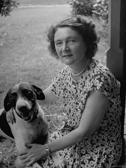 Novelist Marjorie K. Rawlings Petting Her Dog-Nina Leen-Premium Photographic Print