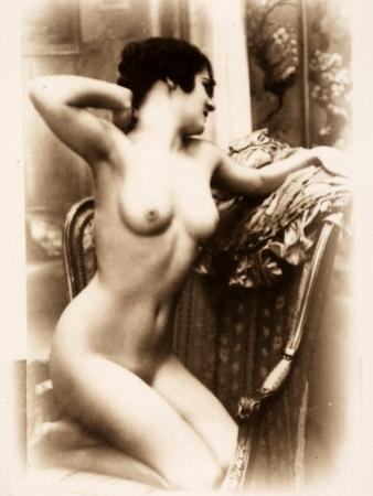 Nude Portrait of a Young Woman Kneeling on an Armchair