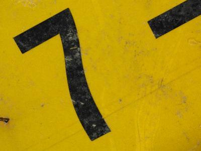 Number Seven on Worn Metal Sign