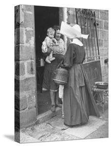 Nun from the Order of Sisters of Charity Visiting a Destitute Family with Supplies