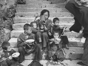 Nuns Administering Care and Food to a Needy Family, During the Famine