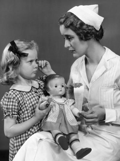 Nurse Consoling Young Girl and Her Doll-George Marks-Photographic Print