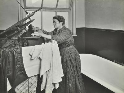 Nurse Using a Steriliser in the Bathroom at Chaucer Cleansing Station, London, 1911--Photographic Print