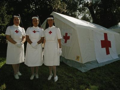 Nurses Stand Ready to Lend Aid at a Horse Jumping Event in Rome-Paul Chesley-Photographic Print