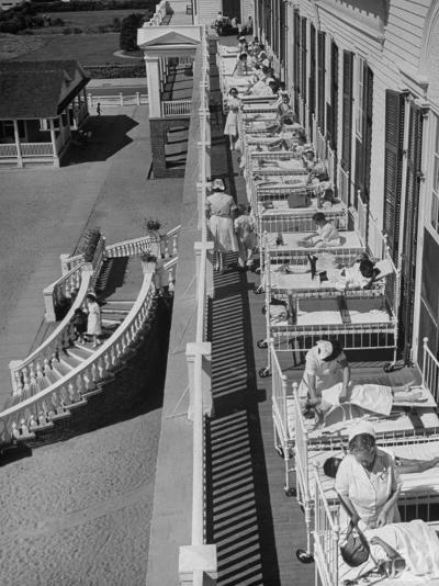 Nurses Tending to Afflicted Children as They Lie on a Sundeck in Sanitarium in Resort-Alfred Eisenstaedt-Photographic Print