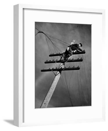 NY Telephone Co. Lineman Wallace Burdick Repairs Telephone Lines Between Valhalla and Brewster-Margaret Bourke-White-Framed Premium Photographic Print