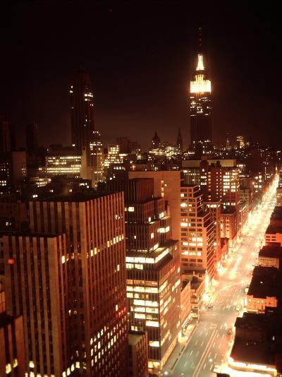 NYC Looking Down Sixth Avenue with Lights After Blackout with Empire State Building in Background-Ralph Morse-Photographic Print
