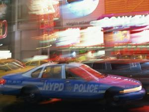Nypd Police Car Speeding Through Times Square, New York City, New York, USA
