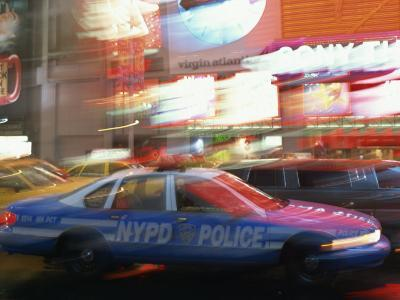 Nypd Police Car Speeding Through Times Square, New York City, New York, USA--Photographic Print