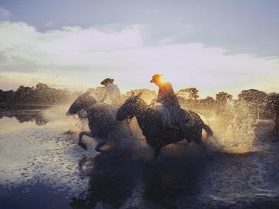 Argentine Gauchos Race across a Lake Near Beron De Astrada
