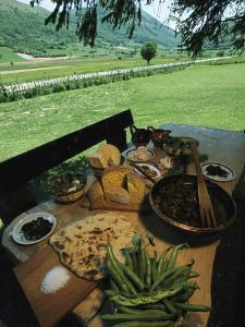Table Spread with a Typical Umbrian Feast of Bread and Lamb Innards by O. Louis Mazzatenta