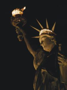 The Statue of Liberty at Night by O^ Louis Mazzatenta