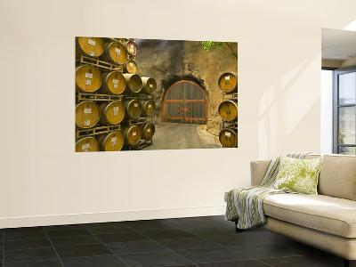 Oak Barrels Stacked Outside of Door at Ironstone Winery, Calaveras County, California, USA-Janis Miglavs-Giant Art Print