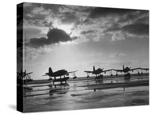 Observation Planes Sitting at Water's Edge at a US Navy Air Base