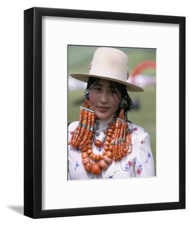 Portrait of a Tibetan Woman Wearing Jewellery Near Maqen, Qinghai Province, China