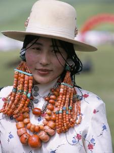 Portrait of a Tibetan Woman Wearing Jewellery Near Maqen, Qinghai Province, China by Occidor Ltd