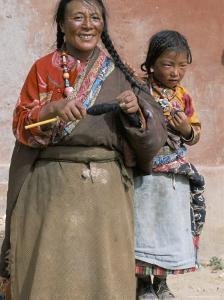 Tibetan Woman Spinning, Qinghai Province, China by Occidor Ltd