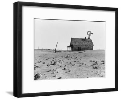 Occupied house in Dalhart, Texas where most are abandoned in the drought, 1938-Dorothea Lange-Framed Photographic Print