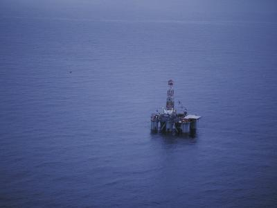 Offshore Oil Rig Surrounded by the Ocean-Jeff Foott-Photographic Print