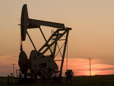Oil Drilling Pump Silhouetted Against the Sunset in North Dakota-Phil Schermeister-Photographic Print