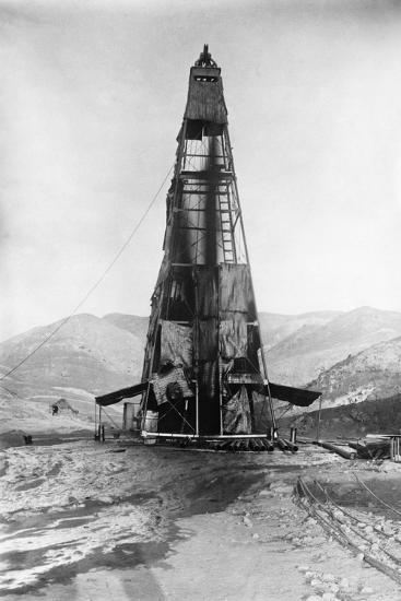 Oil Flowing in a Derrick--Photographic Print