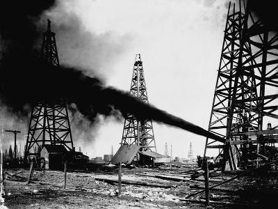 Oil Gushing from Spindletop Hill in Beaumont, Texas--Photographic Print