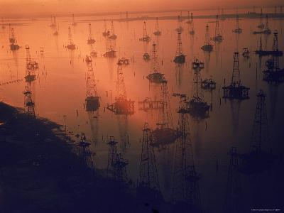 Oil Rigs Dating from the 1920's Dot the Shallows of Galveston Bay-Ralph Crane-Photographic Print