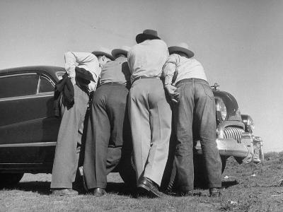 Oil Scouts and Lease Men Huddling over Oil Map on Car Hood before Going on Exploring Tour--Photographic Print