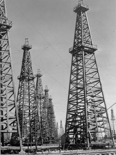 Oil Well Rigs in a Texaco Oil Field-Margaret Bourke-White-Photographic Print
