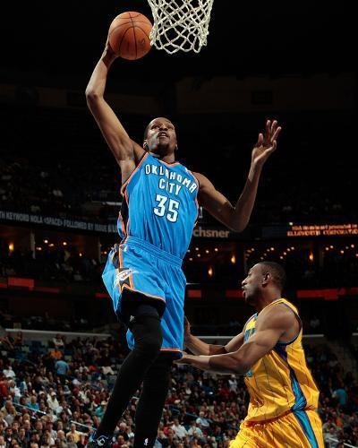Oklahoma City Thunder v New Orleans Hornets: Kevin Durant and D.J. Mbenga-Chris-Photo