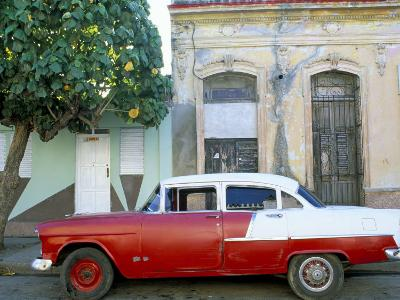 Old American Car Parked on Street Beneath Fruit Tree, Cienfuegos, Cuba, Central America-Lee Frost-Photographic Print