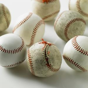 Old and new baseballs gathered together