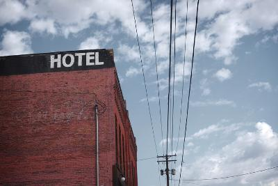 Old Dilapidated Brick Motel with Cloudy Sky- J D S-Photographic Print