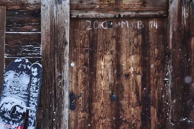 https://imgc.artprintimages.com/img/print/old-farm-door-snowboard-ski-snowfall_u-l-q1evd8k0.jpg?p=0