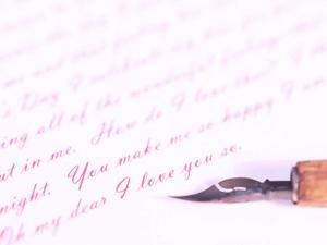Old-Fashioned Fountain Pen Lying on Love Letter